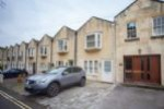 Your property located along a quiet lane of mews homes