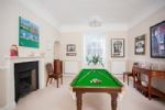 Dining table converts to a pool table